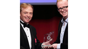 NOEL QUALTER receiving an award from the President of the Magic Circle Scott Penrose